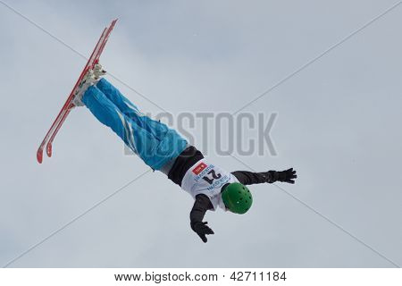 BUKOVEL, UKRAINE - FEBRUARY 23: Zhanbota Aldabergenova, Kazakhstan performs aerial skiing during Freestyle Ski World Cup in Bukovel, Ukraine on February 23, 2013.
