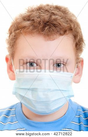 A boy in a protective mask on a white background