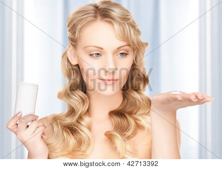 picture of young woman with pills
