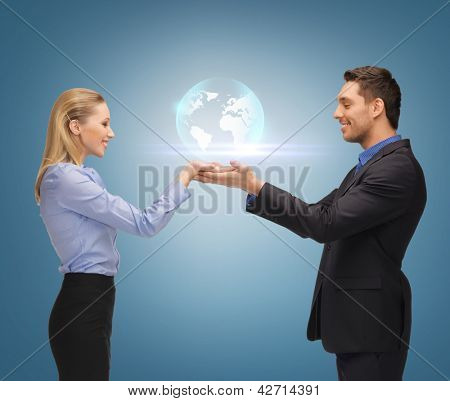picture of man and woman showing earth globe on the palms