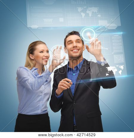 picture of man and woman working with virtual touch screens