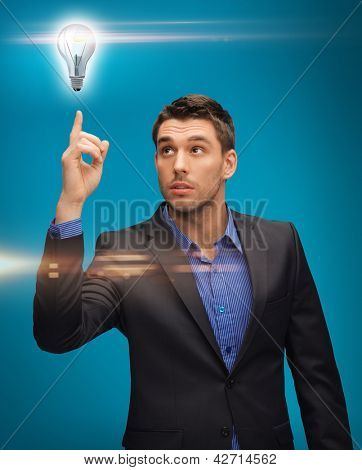 picture of man in suit with light bulb