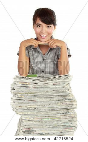 Young Woman Smiling, With A Lot Of Newspaper On Her