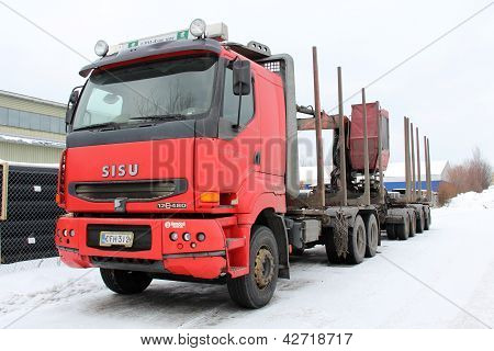 Red Unloaded Logging Truck