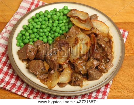 Lancashire hotpot served with peas.