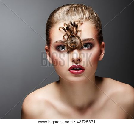 Scary Arachnid Predator On Beauty Woman Face Sitting
