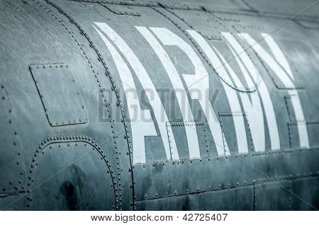 Side view of military plane with inscription.