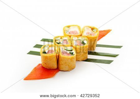 Mexico Maki Sushi - Roll made of Smoked Salmon, Cream Cheese, Cucumber and Spring Onion inside. Mexican Pancake outside. Served on Salad Leaf