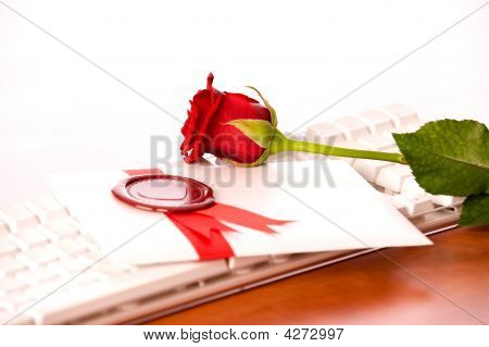Rose And Love-letter On White Keyboard