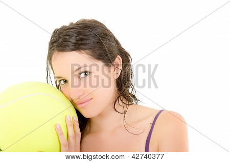 young adult woman with big  tennis ball