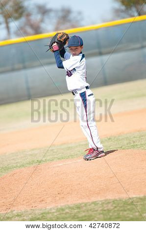 Little League Pitcher Starting His Wind Up.