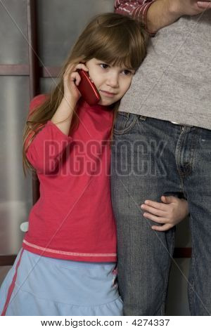 Little Girl Speaking By Phone