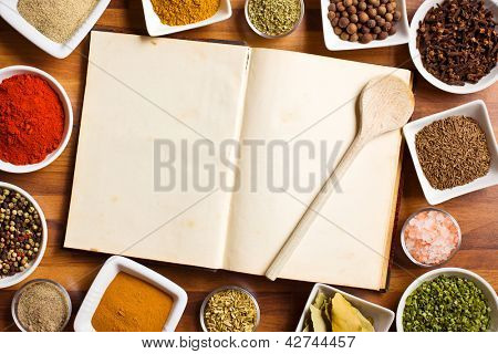 The cookbook and various spices and herbs.