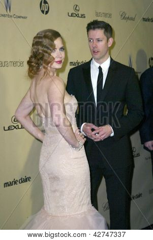 BEVERLY HILLS, CA - JAN. 13: Amy Adams and guest arrive at the Weinstein Company's 2013 Golden Globes After Party on Sunday, January 13, 2013 at the Beverly Hilton Hotel in Beverly Hills, CA.