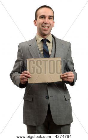 Businessman Holding Cardboard Sign