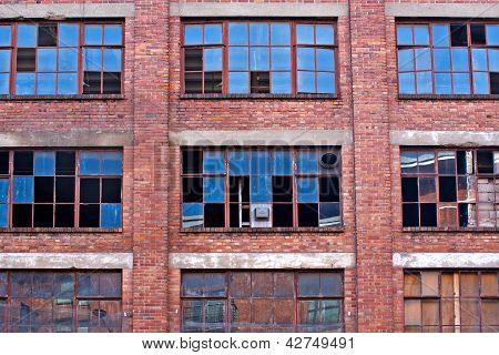 Broken Windows On Old Derelict Building