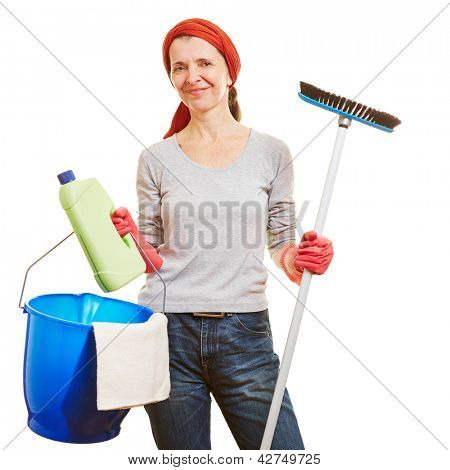 Happy senior woman making spring cleaning with cleaning products