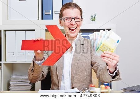 Happy business woman pointing with arrow to Euro money bills