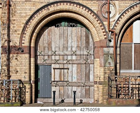 Old Boarded Up Arched Doorway
