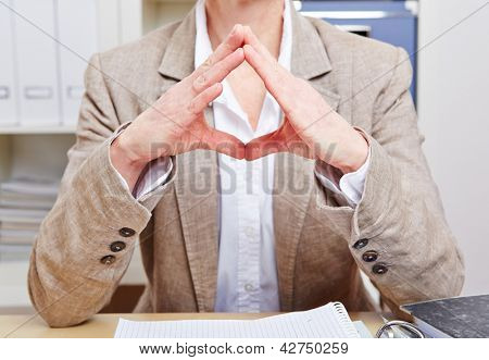 Body language of a senior business woman in her office