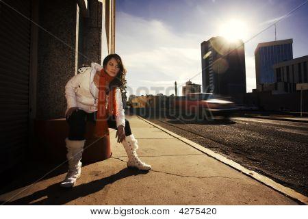 Pretty Hispanic Woman In Urban Setting