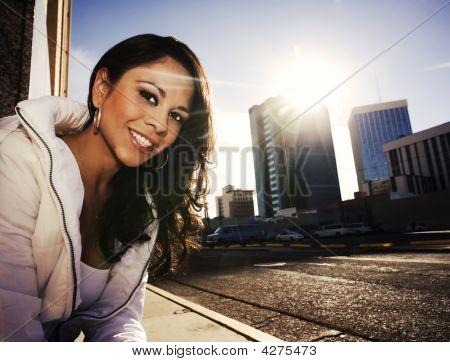 Pretty Woman At Sundown In City