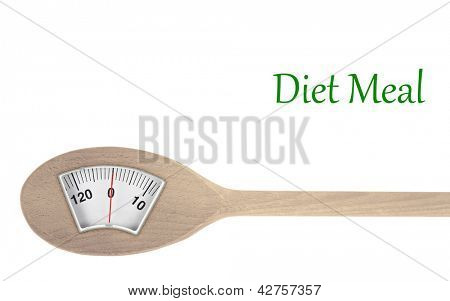Diet meal. Wooden spoon with weight scale