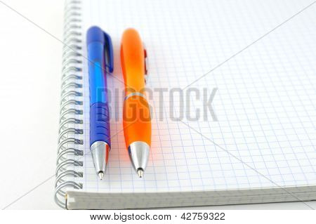 Blue And Orange Pen With Copy-book