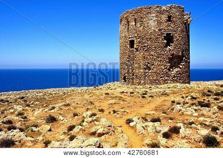 Ancient Watchtower Of Cala Domestica Beach, Sardinia, Italy