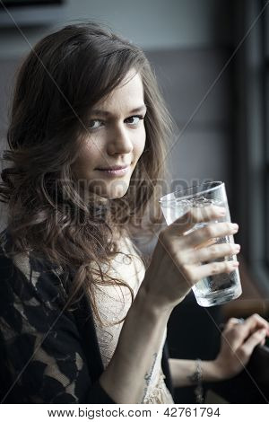 Young Woman Drinking A Pint Glass Of Ice Water