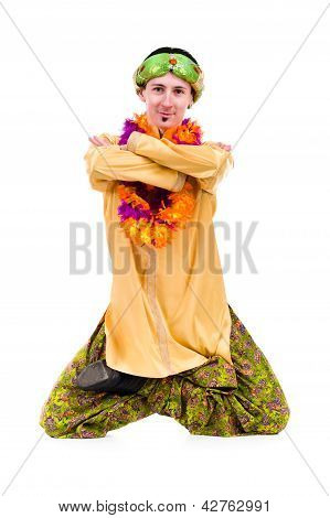 man doing yoga exercise in pose of lotus