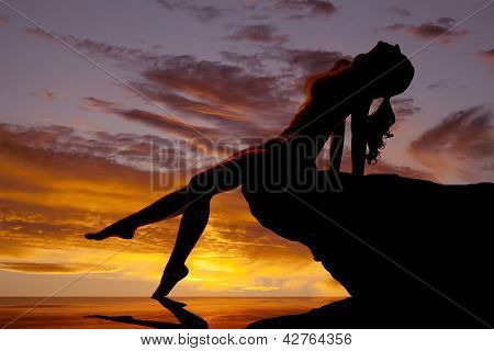 Woman Silhouette By Water Sunset