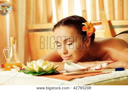 Beautiful young woman taking spa treatments at the salon.
