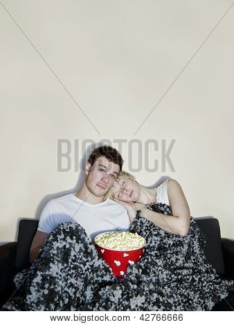 Cute Couple Watching Television