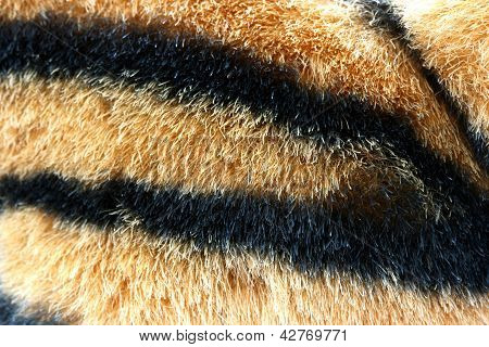 Artificial tiger fur texture detail view