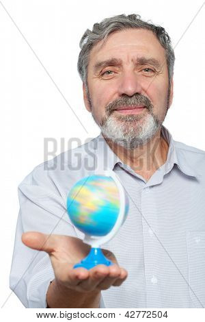 Elderly man holds small globe in his hand, focus on man face