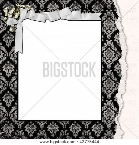 damask frame with torn edge and bow