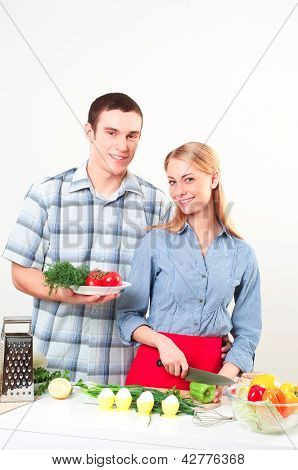 couple of cooking together