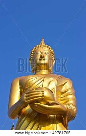 Stand Golden Buddha Statue On Sky In Thailand