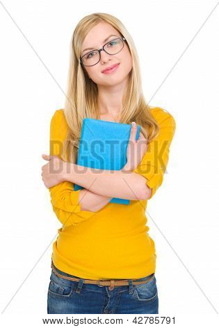 Portrait Of Happy Student Girl In Glasses Hugging Book