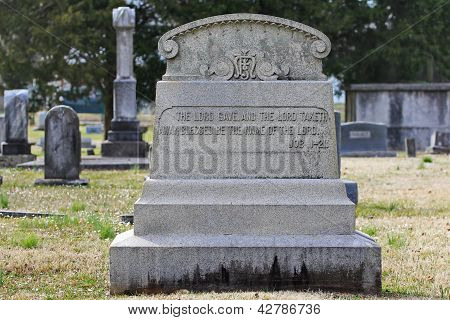 Old elaborate tombstone with quote from Book of Job Inscribed
