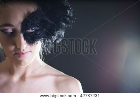 portrait of sexy woman with black feather half mask for Venice desire concept
