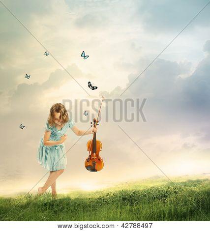 Menina com violino em uma paisagem fantasia