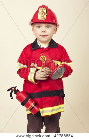 Cute Young Boy in a Fireman's Costume