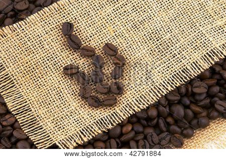 With Roasted Coffee Beans On Rustic Fabric.