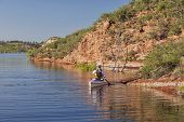 stock photo of horsetooth reservoir  - canoe paddler  - JPG