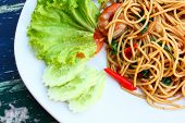 Spicy Seafood Spaghetti With Many Kind Of Herbs poster