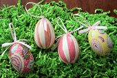 pic of decoupage  - Pretty decoupage egg decorations on shredded green easter grass - JPG