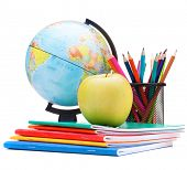 Globe, notebook stack and pencils. Schoolchild and student studies accessories. Back to school conce