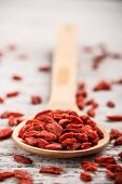 image of tablespoon  - Wooden tablespoon of dried goji berries - JPG